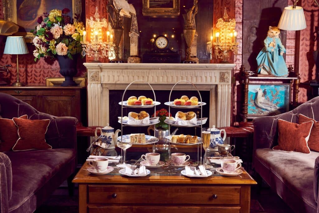 Afternoon Tea Laid On A Table In Front Of A Fireplace