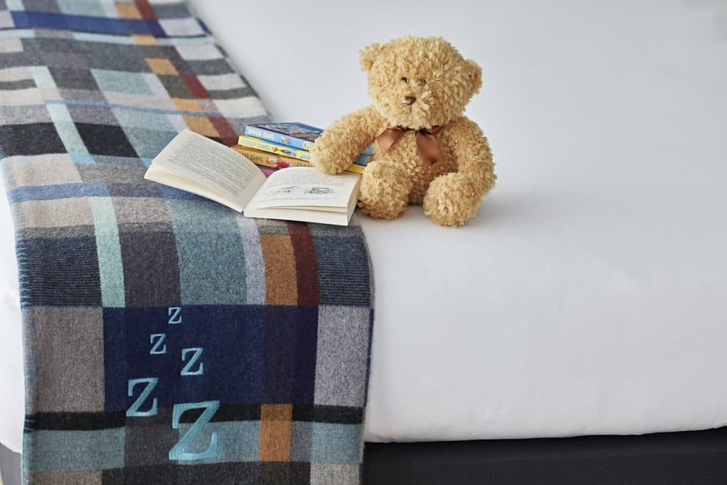 Teddy Bear And Books On A Bed At The Zetter Hotel